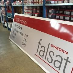 3x1 m skylt med öppettider till Falsat